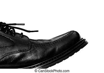 A black leather shoe