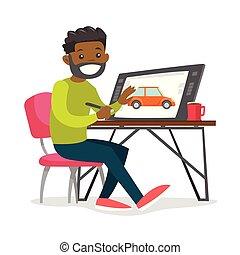 A black man graphic designer works at the office desk.
