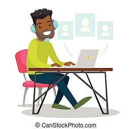 A black man in headset working at the office desk.