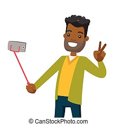 A black man making selfie on his cellphone with a selfie stick.