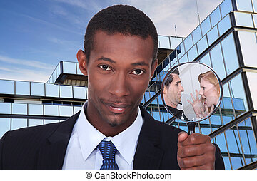 a black man showing a couple dispute through a magnifying...
