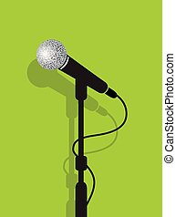 a black microphone stand on a green