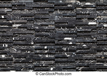 A black stone wall