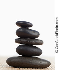 A black stones stack against a white background