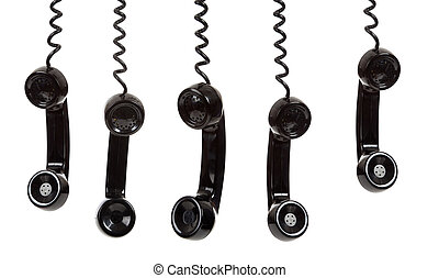 five black hanging telephone receivers on a white background