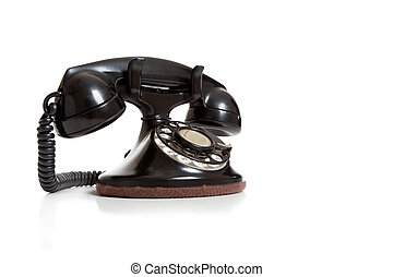 A black vintage telephone on white