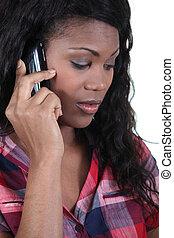 a black woman at phone