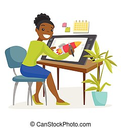 A black woman graphic designer works at the office desk.