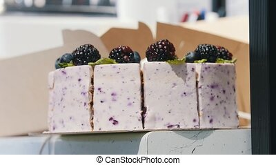A blackberry cake. Blackberries on the top of the cake.