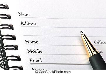 A blank page of open telephone - address book.