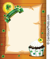 A blank paper with a St. Patrick's Day greeting and a cupcake