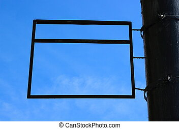 A blank rectangular advertising sign framing a blue sky background.