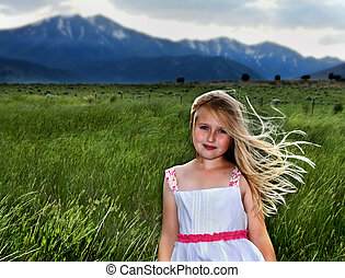 a blond girl with wind blowing through her hair