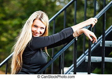 Blond woman s outdoor portrait