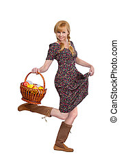 blonde girl with a basket of ripe apples