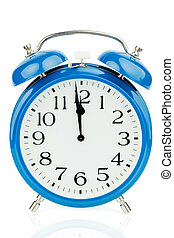 alarm clock on white background - a blue alarm clock on ...