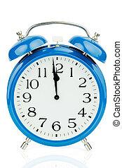 alarm clock on white background - a blue alarm clock on...