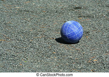 Blue bocce ball on a court