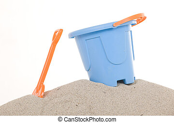 A blue Bucket and  shovel on the beach