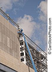 A Blue Cherry Picker Platform on a construction site