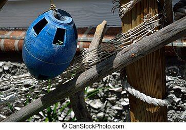 A blue float - Nautical objects including a fishing net and ...