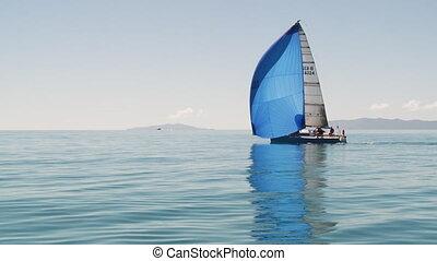 A blue mast sailed sailboat - A long shot of a blue sailed...