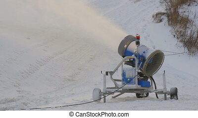 A blue snow blower on the resort