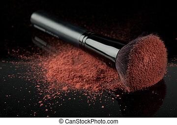 a blush brush, with pink loose blush - a flat blush brush...