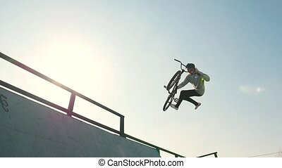 A bmx riders training their skills in the skatepark. Racing...
