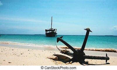 A boat anhcored near the sand coast