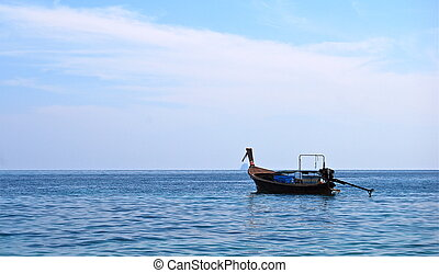A boat in the middle of the sea, Ph