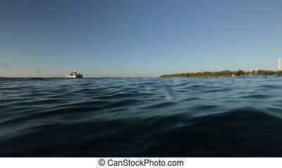 A boat on the sea and the shore - A hand held POV shot of a...