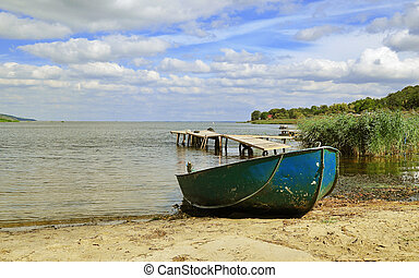 A boat on the shore of the Dnepr river