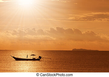 a boat to the sunset