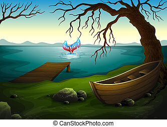 A boat under the tree near the sea with a big fish