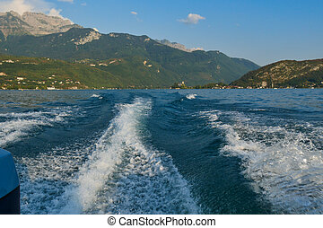 boat wake on the blue lake of Annecy, France