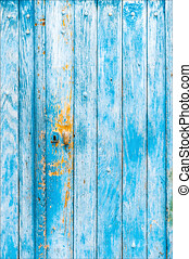 A bolt with details of old wooden doors, details of old wooden doors with a bolt