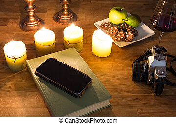 A book and burning candles