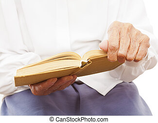 a book in an old woman's hand