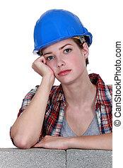 A bored tradeswoman