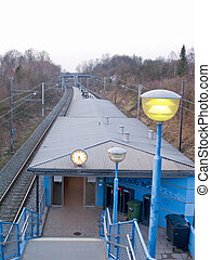 A boring railway station in an urban area with space to copy