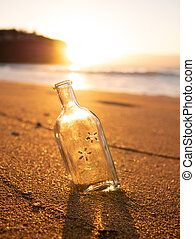 A bottle buried in the sand