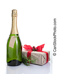 A bottle of alcohol and a gift on a light background.