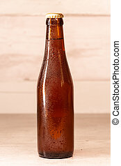 a bottle of amber beer with its capsule