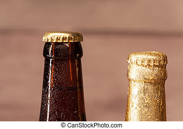 a bottle of blond beer and a bottle of amber beer