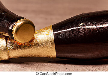 a bottle of blonde beer and a bottle of amber beer lying down