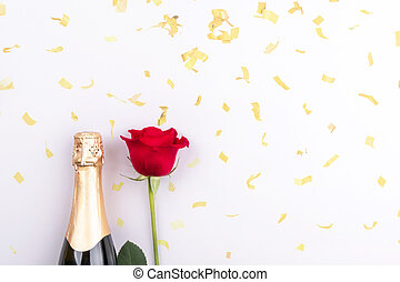 A bottle of champagne and a red rose on a light background with sequins. The concept of Valentine's day