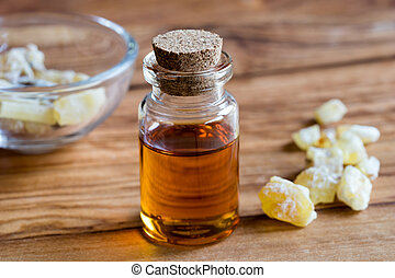 A bottle of frankincense essential oil with frankincense...