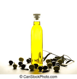 A bottle of olive oil with olives on white background