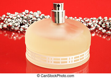 A bottle of perfume on a red background